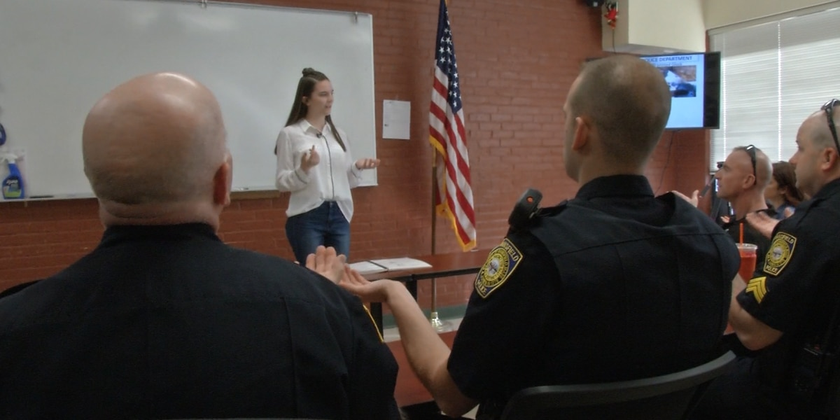 High school student teaches police sign language